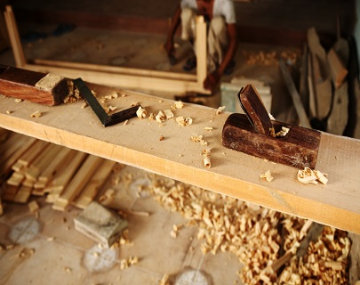 Block Plane and other Carpentry tools on Teak Wood Plank in Carp